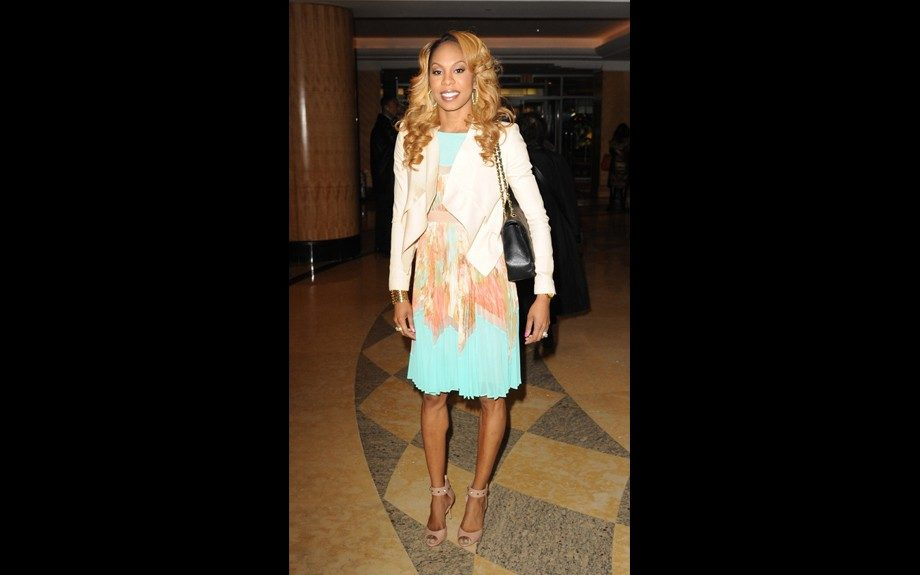 Sanya Richards Ross was spotted in NYC in a very sweet BCBG MAXAZRIA Pleated Print Dress and a pair of Valentino Rockstud Ankle Strap Peep Toe Pumps; perhaps she was heading to a romantic dinner. Photot: Splash