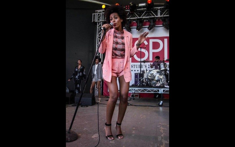 Solange Knowles rocks the stage at the 2013 SXSW Festival in a Clover Canyon Rhinestone Jacket, matching rhinestone shorts, a Marni Bird check shirt, and a pair of Nicholas Kirkwood Elaphe leather sandals. Photo: INF