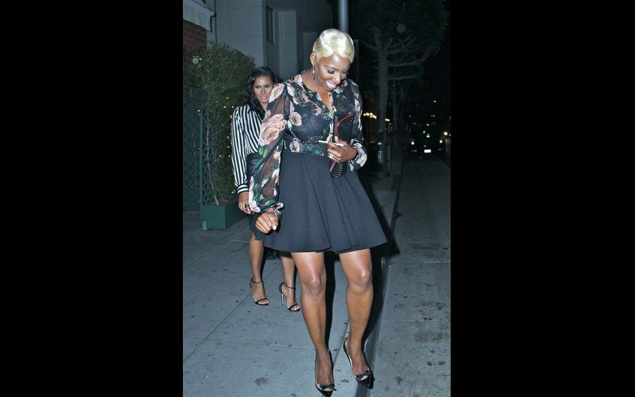 Reality girls Nene Leakes and Laura Govan got in some fine dining at Mr Chow in Beverly Hills, and Nene opted for a Dolce & Gabbana Floral Silk Blouse, bow pumps, and a flared black skirt. Photo: Splash