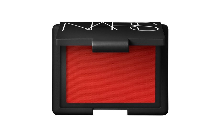 """Don't forget the coral cheeks: <a href=""""http://www.narscosmetics.com/color/cheeks/blush/blush/exhibit-a"""" target=""""_blank"""">NARSBlush in Exhibit A </a>($29)"""
