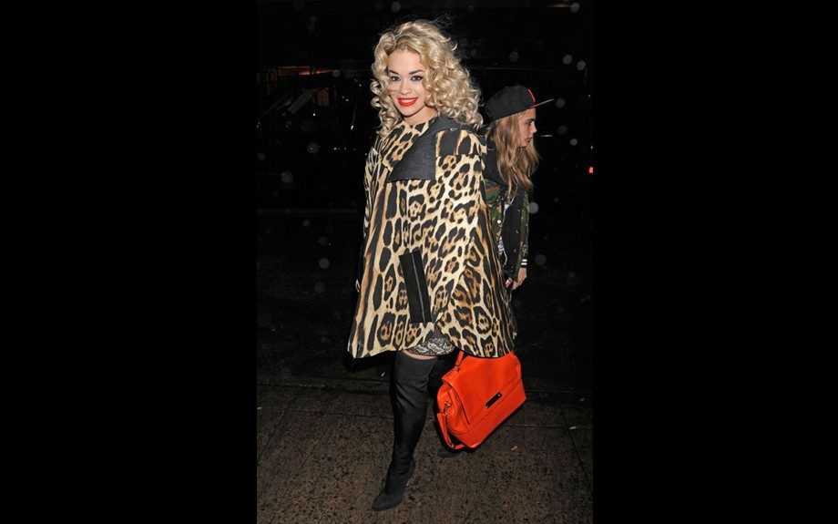 Rita Ora rocks a Just Cavalli cape, Diane Von Furstenberg tote, and over-the-knee boots while heading to the Highline Ballroom in NYC. Photo Credit: WireImage