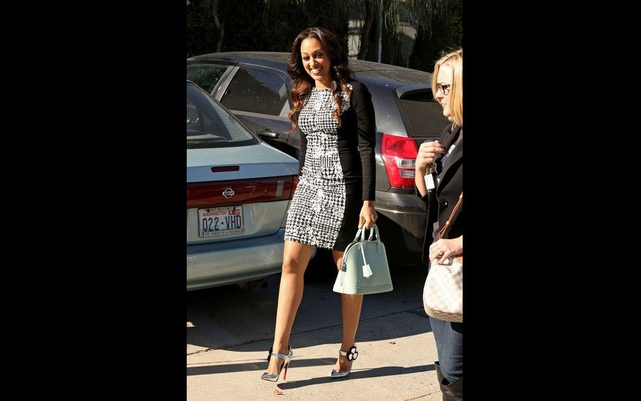 Tia Mowry spotted in West Hollywood ASOS Houndstooth Panel Bodycon Dress, and Christian Louboutin Silver Pensee Mary Jane Flower Pumps. Photo Credit: WireImage
