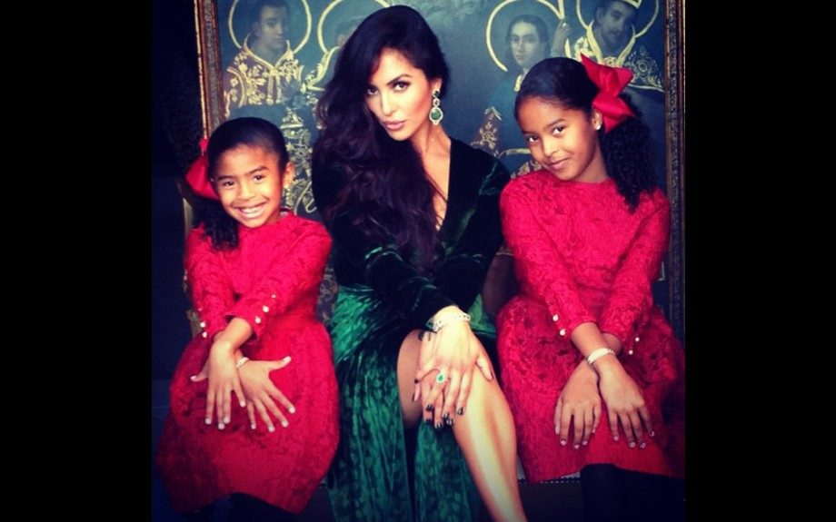 Vanessa Bryant posed for a holiday shot alongside daughters Natalia and Gianna in a Green Velvet Deep V-Neck Gown by Gucci. Photo Credit: Vanessa's Instagram