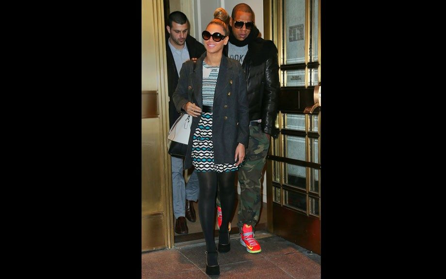 Beyoncé Christmas shops with hubby Jay-Z in a Milly Ainsley Patterned Dress, finishing her look with a greyish trench, Prada Baroque Minimal sunglasses, velvet Mary Janes, and her Diane Von Furstenberg bag. Photo Credit: INF