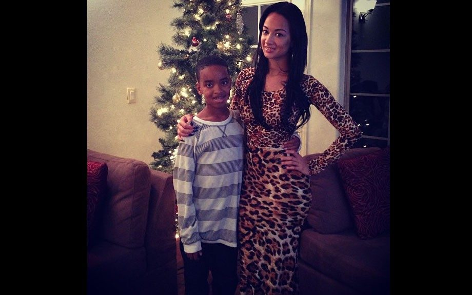 Draya heads home for the holidays to be with her son in a leopard printed maxi dress. Photo Credit: Draya's Instagram