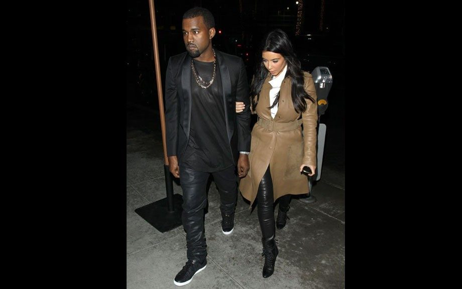 Kim and Kanye wear matching leather pants matched with neutral colors as they head to dinner at Spago, in Beverly Hills. Photo Credit: Splash