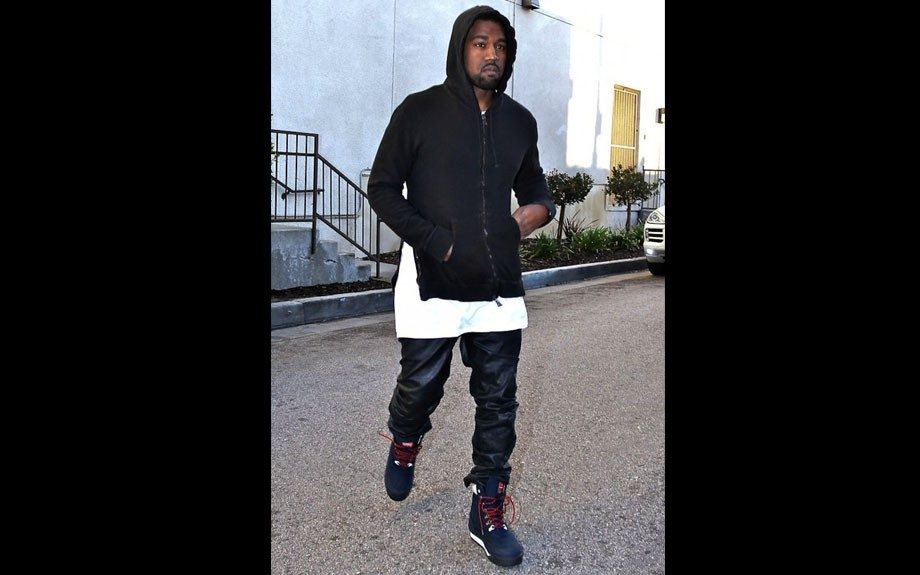 Kanye West was recently spotted in Studio City, California wearing his favorite black leather pants, a Balmain zip hoodie, and  Patta x Kangaroos Woodhollow Heritage Hiking Boots. Photo Credit: Splash
