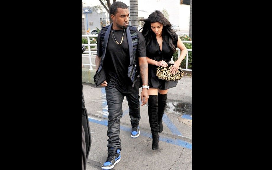 Kanye West and Kim Kardashian eat out at Kung Pao Bistro, with Kanye in all black, a vest, and Air Jordans, and Kim in all black, over-the-knee boots, and a Dolce & Gabbana Gold Miss Dea Embroidered Suede clutch. Photo Credit: INF
