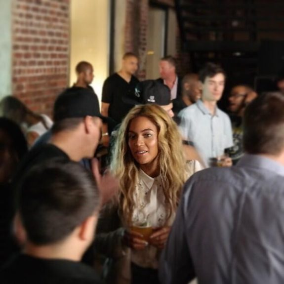 Beyonce tried to duck and dodge the cameras, but we got a sneak peak at her men's wear inspired look, and loose golden waves.