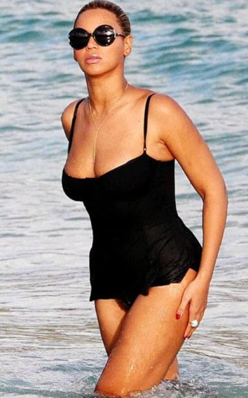 After giving birth just a few short months ago, Beyonce opted for this low cut, black peplum one-piece. Tip: If you're looking to hide some things, black is a great option as it is slimming by default. If not, try combining the coral trend with the peplum trend and let us know how it