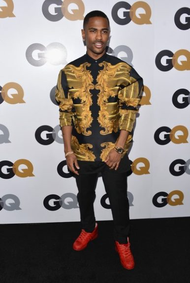 Big Sean rocked black and gold in style at the GQ party in a printed Katie Eary shirt, Dior slacks, Rolex watch and Adidas sneakers. Photo Credit: Getty