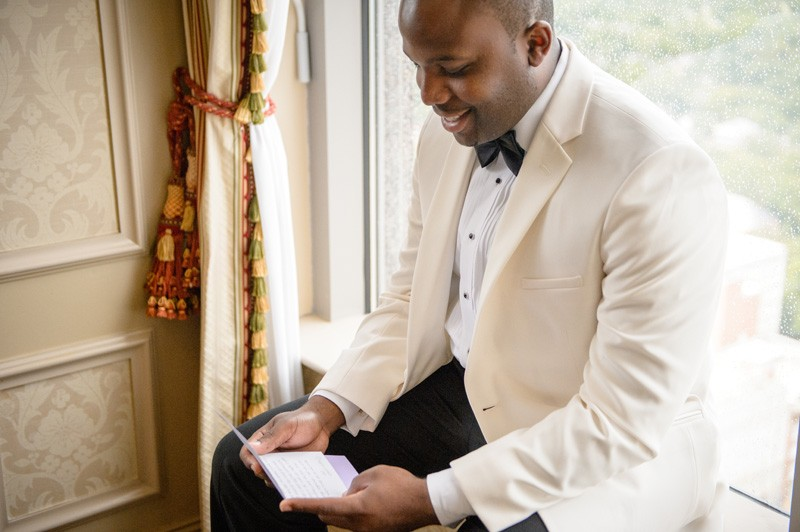The groom as he reads his special love note.