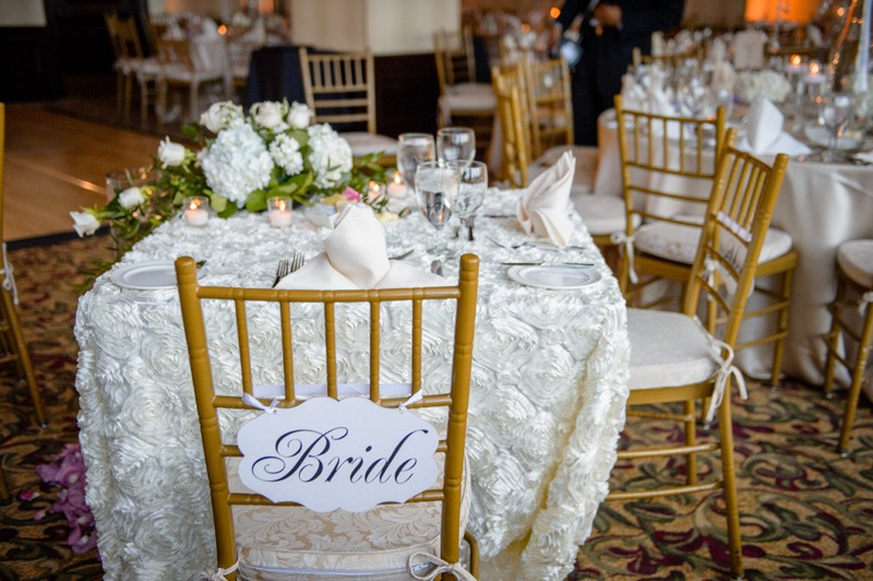 We love the chic setup for the bride and groom. Very non-traditional, yet still elegant.
