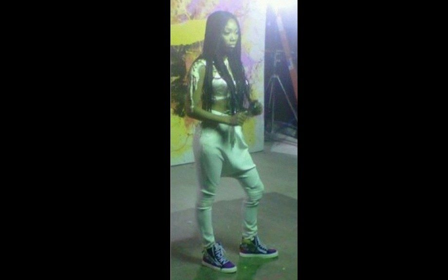 "Brandy on ""Put It Down"" video shoot in mint green harem paints, a cropped top, and blue sneakers"