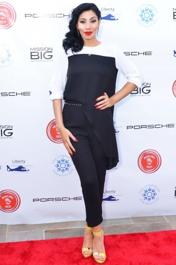 Bridget Kelly kept it simple and chic in a black and white top and trouser set by BCBG. While we love her red lip, we feel like something is missing in the makeup department. <em>Photo</em>: WENN