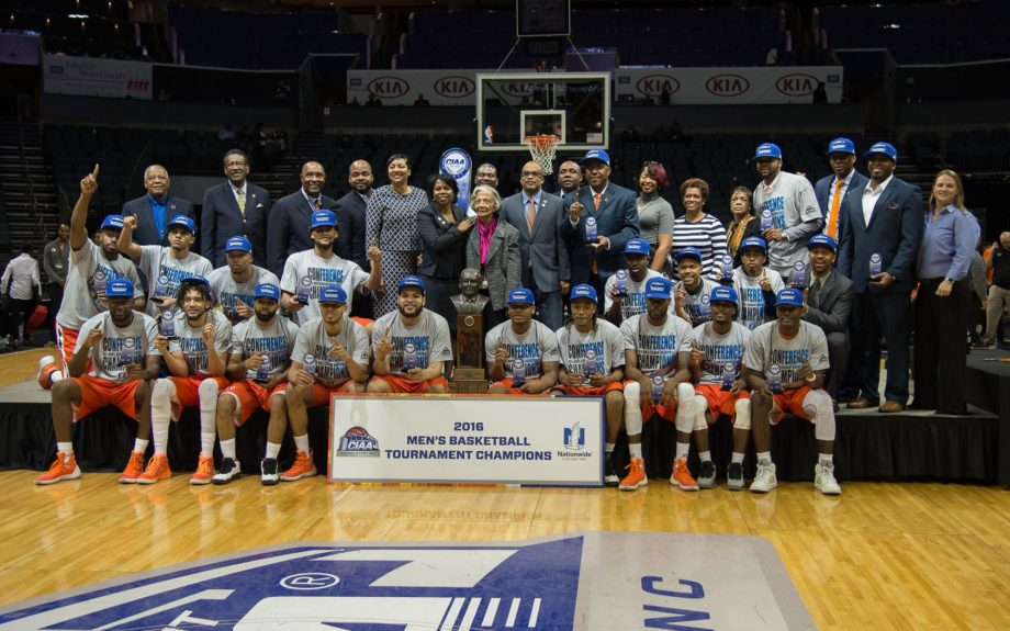 <p> CIAA Commissioner Jacqie McWilliams presents the championship trophy to Virginia State University</p>