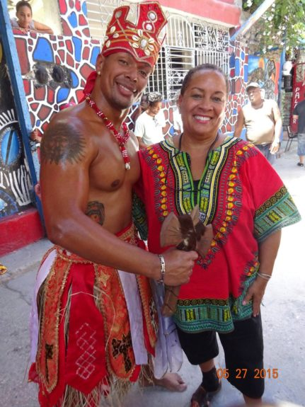 Lifer Katie Sanchez poses with Chango, the Orisha of war, music and dancing.