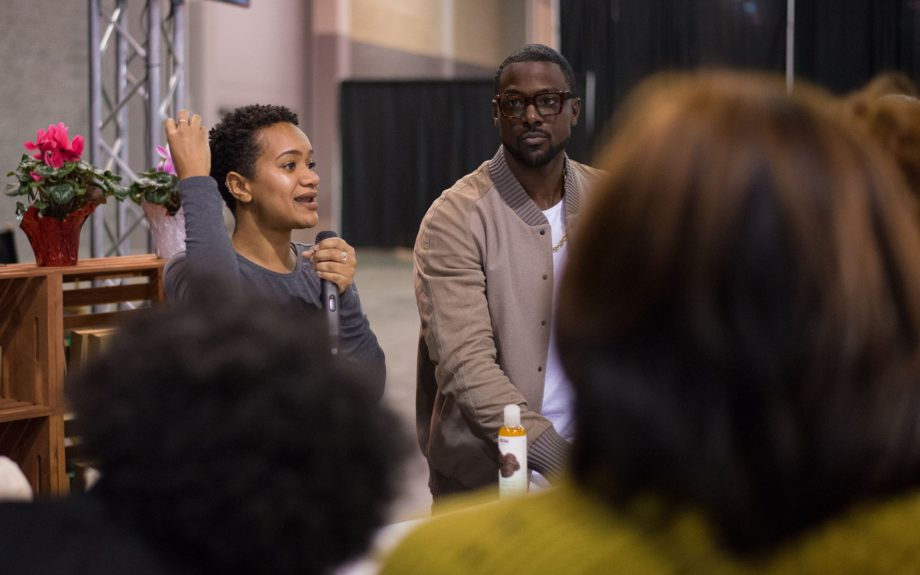 <p> A crowd gathers at the Toyota Green Initiative to learn about living green or maybe for Lance Gross (right), here with poet Alex Elle (left).</p>