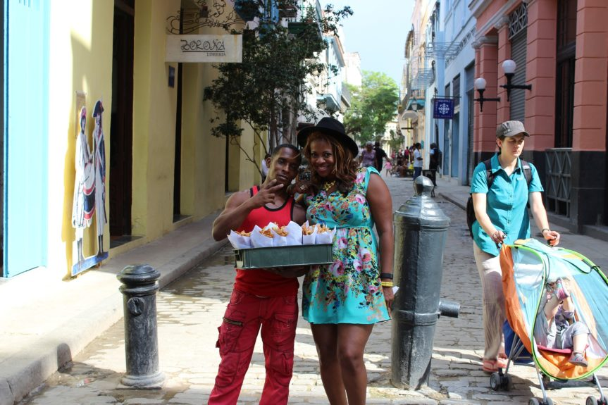 Claire Soares, founder of Up in the Air Life, grabs a snack and supports a local street vendor.