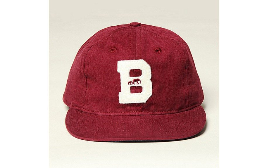"A cap with no frills, just plain ole' heritage. Cotton BKc + Ebbets Field Cap ($49.00, <a href=""http://thebkcircus.com/shop/bkc-ebbets-field-cotton-cap-burgundy/)"">thebkcircus.com</a>)"