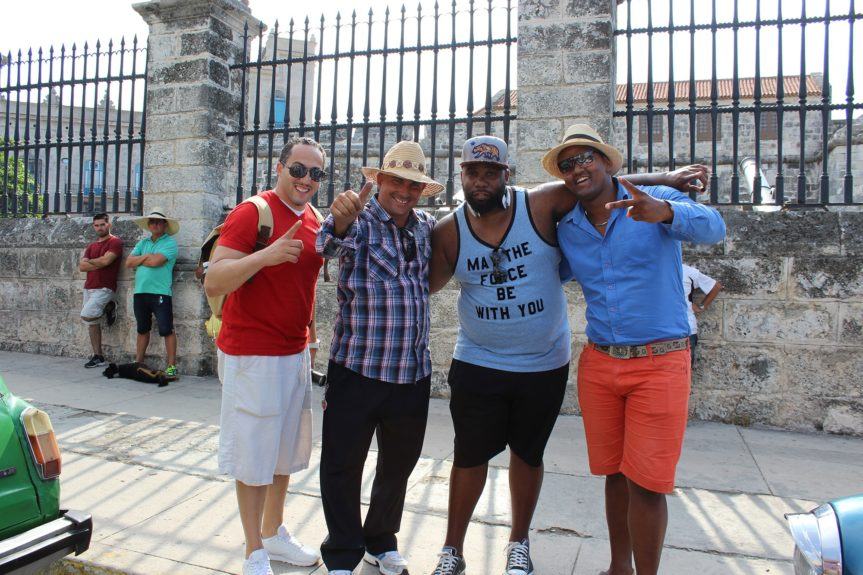 "Up in the Life's travelers call themselves ""Lifers,"" reflecting their dedication to the group. Lifers Jevon Davis and Jason Ridgel chat it up with Cuban locals in Old Havana."