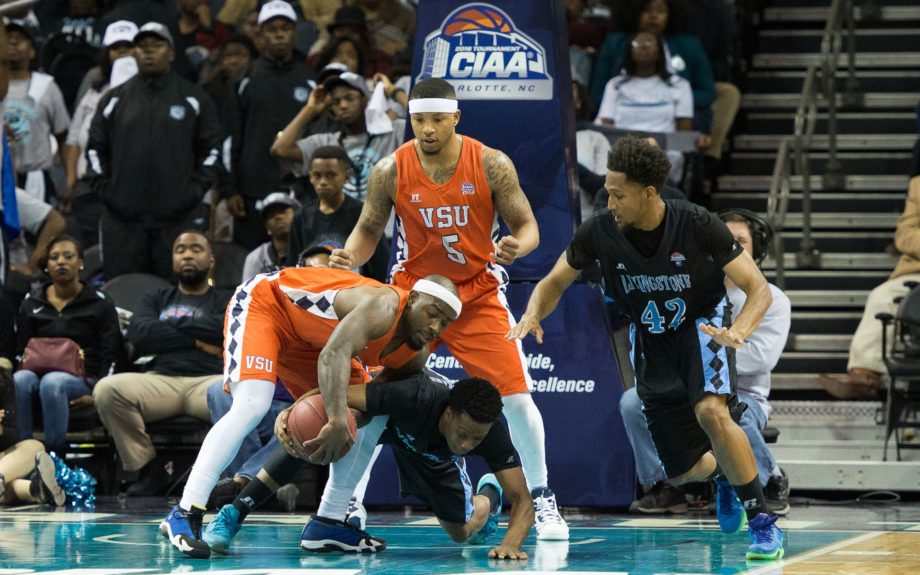 <p> Virginia State guard Waymond Wright(1) battles for the ball in the closing seconds of the CIAA Men's Championship against Livingstone College</p>