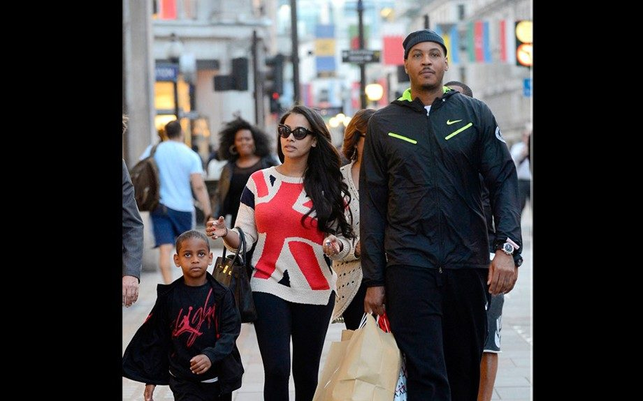 Carmelo rocks a black Nike tracksuit, with neon accent, while Lala wears a sweater that's of course red, white, and blue. Kiyan wears a Jordan t-shirt, black jacket, and black pants. Photo Credit: INF