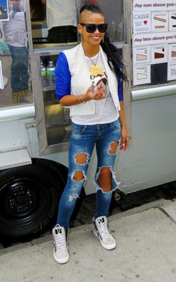 Cassie Ventura epitomizes trendy, bad-girl style serving ice cream sandwiches in torn jeans, a Rodarte tee and a cropped jacket. She adds a final touch with a pair of hightop sneakers, a gold chain and black shades