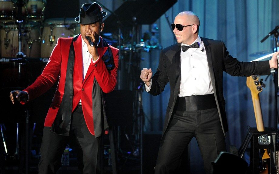 Ne-Yo, left, and Pit Bull perform onstage at the Pre-GRAMMY Gala & Salute to Industry Icons with Clive Davis honoring Richard Branson, Saturday, Feb. 11, 2012, in Beverly Hills, Calif. (AP Photo/Vince Bucci)