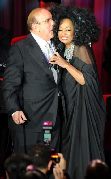 Clive Davis and Diana Ross speak onstage at the Pre-GRAMMY Gala & Salute to Industry Icons with Clive Davis honoring Richard Branson, Saturday, Feb. 11, 2012, in Beverly Hills, Calif. (AP Photo/Vince Bucci)