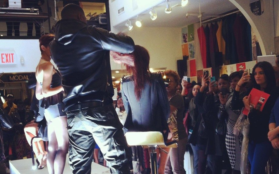 Keith Campbell goes to work on a model's hair at his 'Decide to be Beautiful' book launch