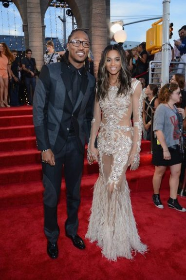 Cute couple alert. Ciara looks amazing in an embellished and mesh Givenchy gown, similar to what Beyoncé wore to the 2012 MET Ball. And we love the unique textures and patterns Future's suit is giving us! Photo Credit: Getty