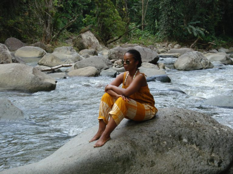 Crystal Whaley meditating in paradise after a swim in the El Yunque Rainforest