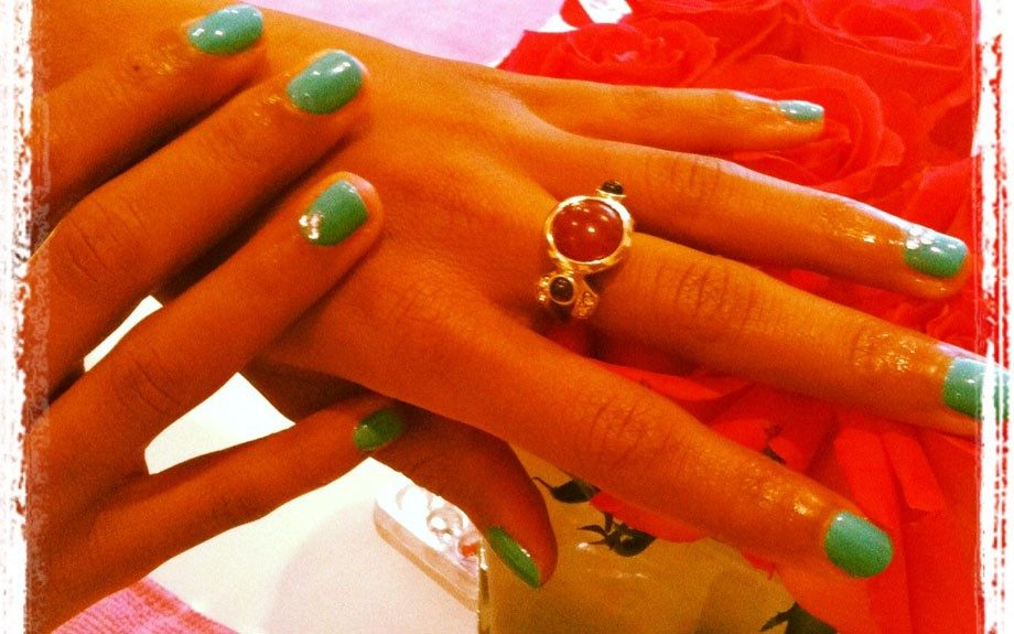 Associate Beauty Editor, Janell Hickman, shows off her turquoise mani with a hint of sparkle at Sprinkles