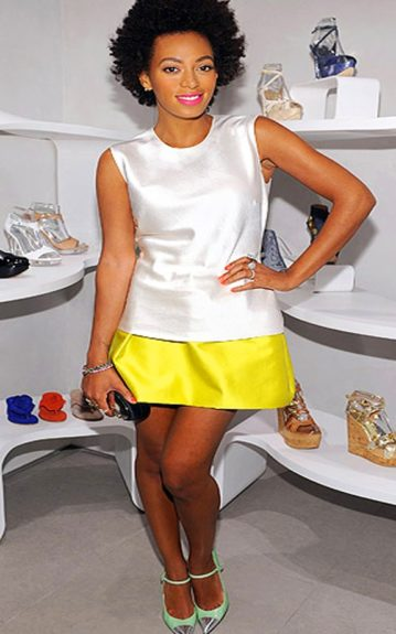 Here, Solange doubles the colorblocking in a white structured tank with a bright yellow skirt and a pair of Stuart Weitzman Steel Cap-Toe Maryjane Heels