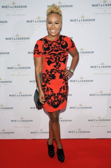 Emeli Sandé was spotted on hand at the Moët & Chandon's 270th Anniversary Party in a printed red and black Alexander McQueen knit dress, paired with black patent point toe booties. <em>Photo</em>: Getty