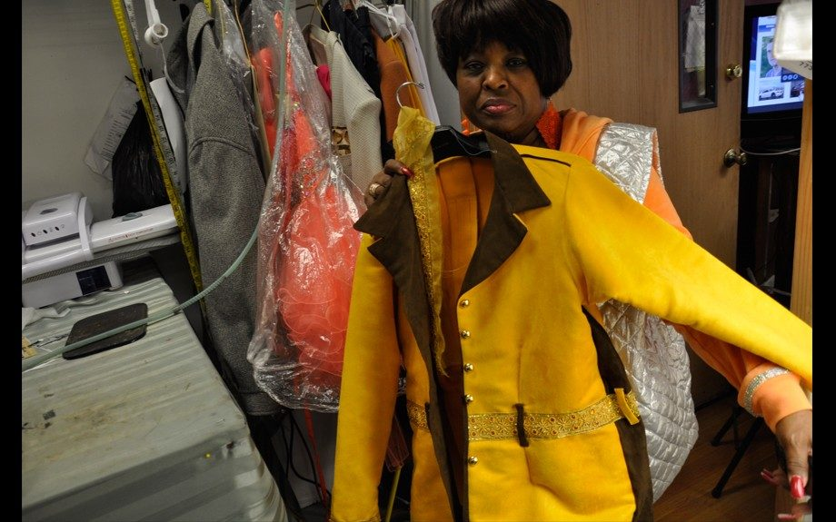 Audrey Wright shows jacket made at her organization, Gordie's Foundation in Englewood