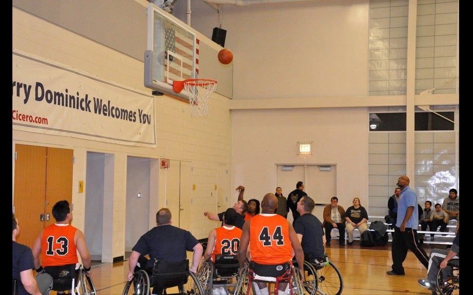 Eric Wilkins participates in a wheelchair basketball game
