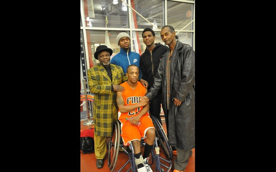 Don Dirk, two Urban Prep Academy students, Bo Stringer, and Eric Wilkins (in wheelchair)