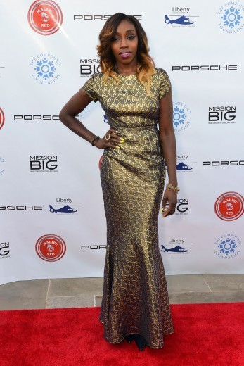 Estelle gives us some sexy shine, in a golden metallic Issa gown that looks awesome paired with her ombré waves. <em>Photo</em>: WENN