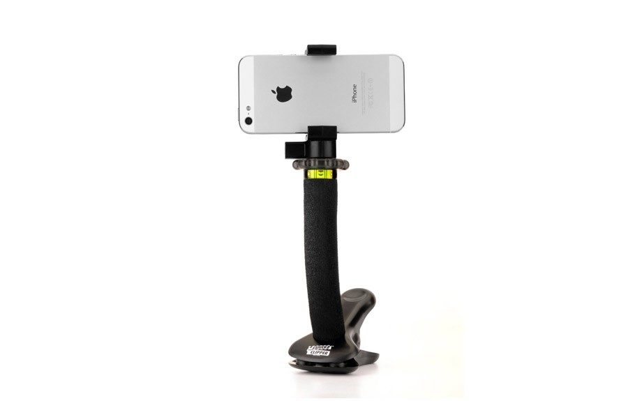 "Keep the tech savvy big man organized with this Clip Tripod for Smartphones and Cameras. $29.95; <a href=""http://www.keepamerica.com/"">www.KeepAmerica.com</a>"