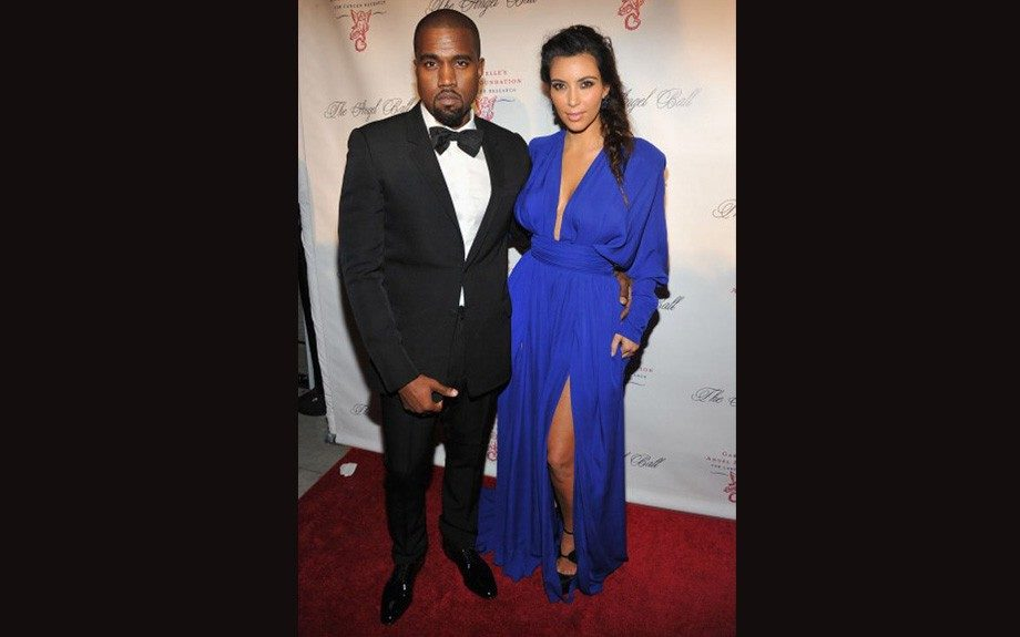 Kanye looks great in a tux, beside his girlfriend Kim Kardashian in her royal blue Balmain gown and Thierry Mugler pumps.