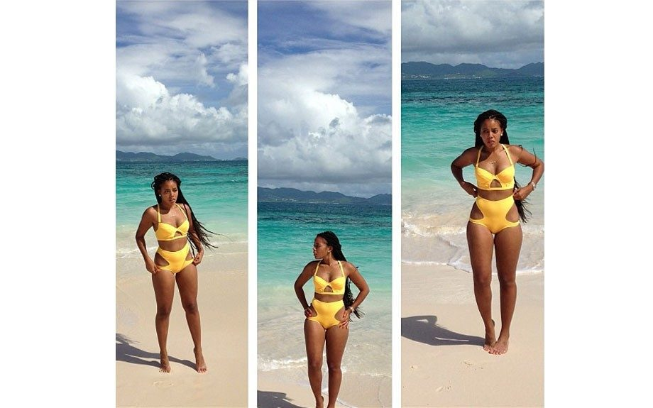 <em>106 & Park</em> host Angela Simmons is a total beach babe in Andrea Iyamah Swimwear design.