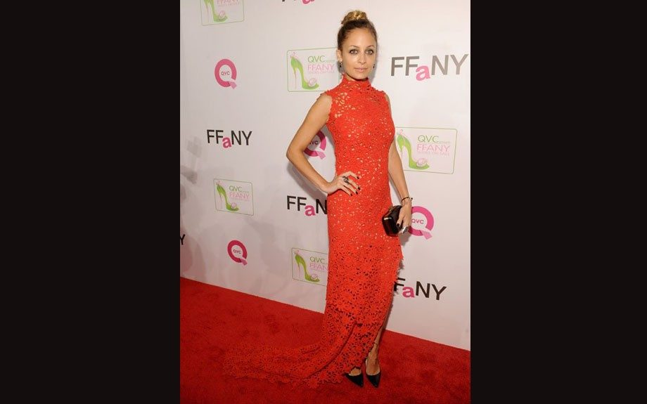 """Nicole Richie was in attendance at the QVC Presents """"FFANY Shoes On Sale"""" event in NYC rocking a red lace dress from Scanlan & Theodore's Spring 2012 collection."""