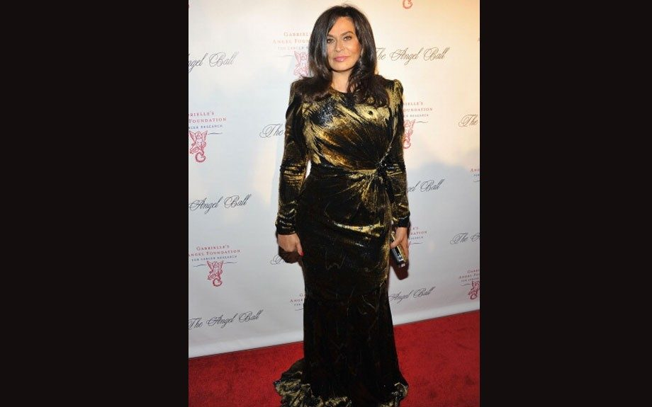 Tina Knowles was elegant in her gold and black gown.