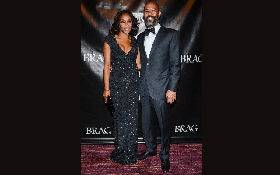 June Ambrose attended the 42nd Annual BRAG (Black Retail Action Group Gala) in NYC wearing a Moschino dress, with her arm candy for a husband.