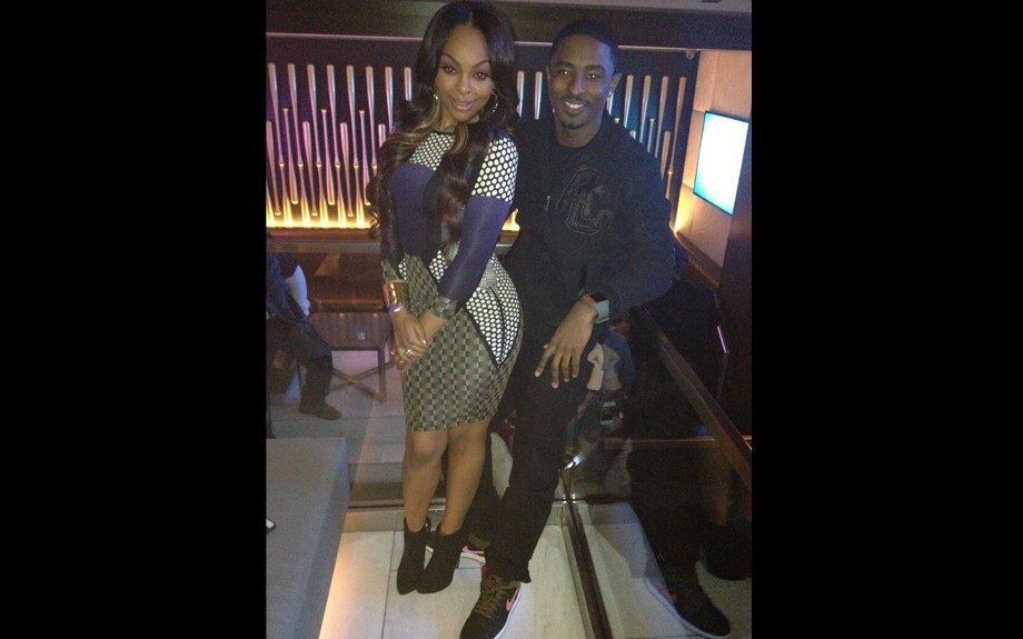 New 106& Park host Shorty Da Prince, and Paigion pose together at the 40/40 club in NYC, with Paigion rocking a printed curve-hugging long sleeve dress by TopShop. Photo Credit: Paigion's Instagram