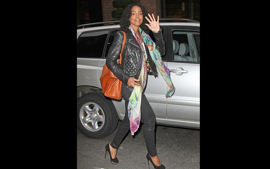 Kelly Rowland rocked Charlotte Olympia Pumps with a J Brand quilted biker jacket, and gave some spice with a printed scarf, and J Brand black coated skinnies. Photo Credit: WireImage