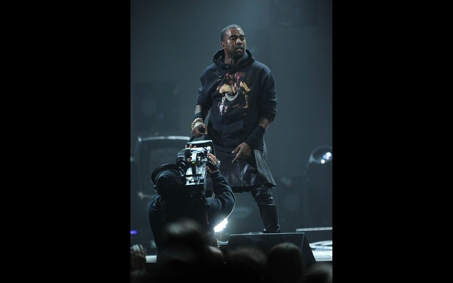 Kanye West performed at the 12-12-12 Hurricane Sandy Benefit Concert wearing a leather skirt he paired with his Pyrex Religion Hoodie.Photo Credit: WireImage