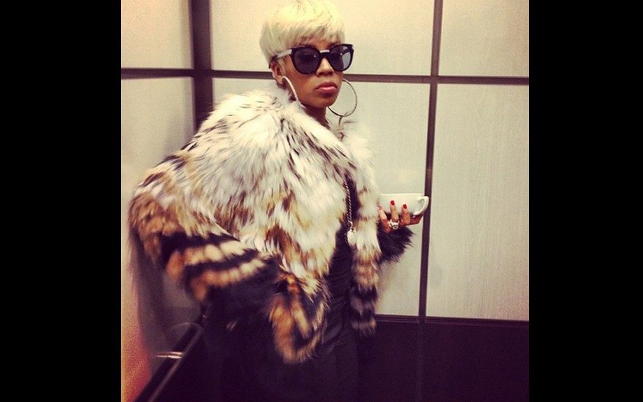 Keyshia Cole at 97.9 The Beat to introduce her forthcoming shoe line in a Cassius Tersk Fur Jacket by Theory. Photo Credit: Keyshia's Instagram